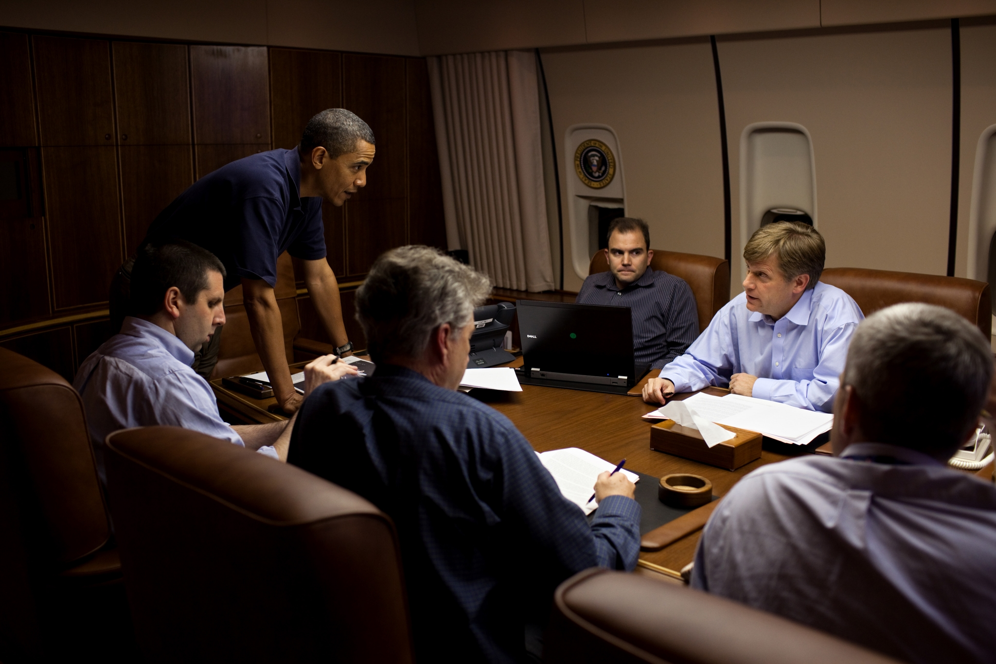 President Barack Obama is briefed by, from left, NSC Chief of Staff Mark Lippert, Former U.S. Ambassador to Russia William J. Burns, Deputy National Security Advisor for Strategic Communications Ben Rhodes, NSC Senior Director for Russian Affairs Mike McFaul, and Deputy National Security Advisor for Strategic Communications Denis McDonough, in the Conference Room aboard Air Force One, during a flight to Moscow, Russia, July 5, 2009. (Official White House Photo by Pete Souza)