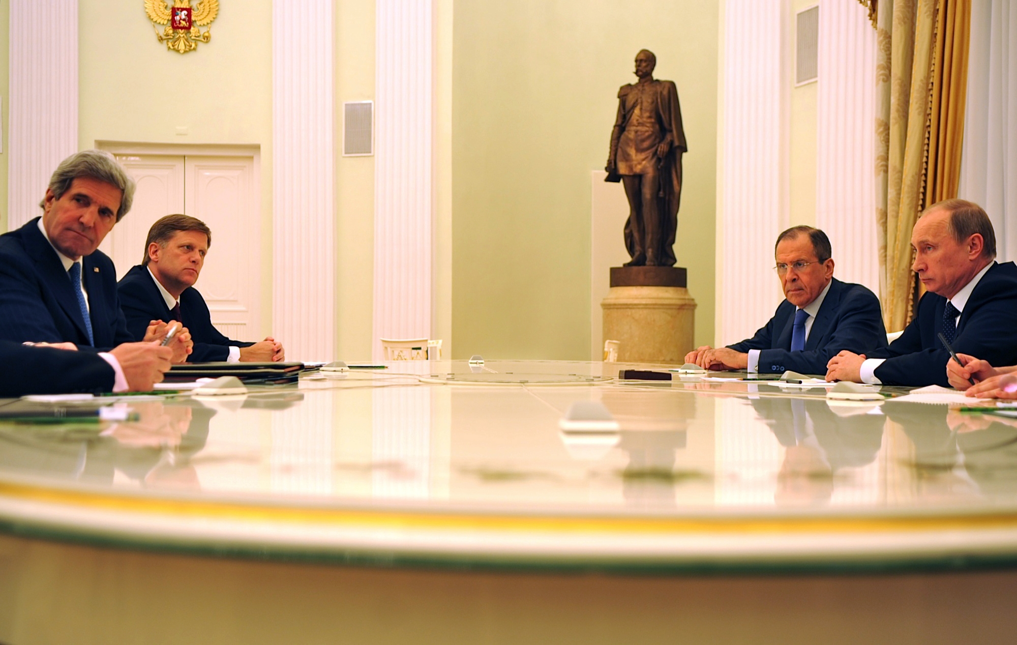 U.S. Secretary of State John Kerry, accompanied by U.S. Ambassador to Russia Michael McFaul meets with Russian President Vladimir Putin and Russian Foreign Minister Sergey Lavrov in Moscow, Russia, on May 7, 2013. [State Department photo/ Public Domain]